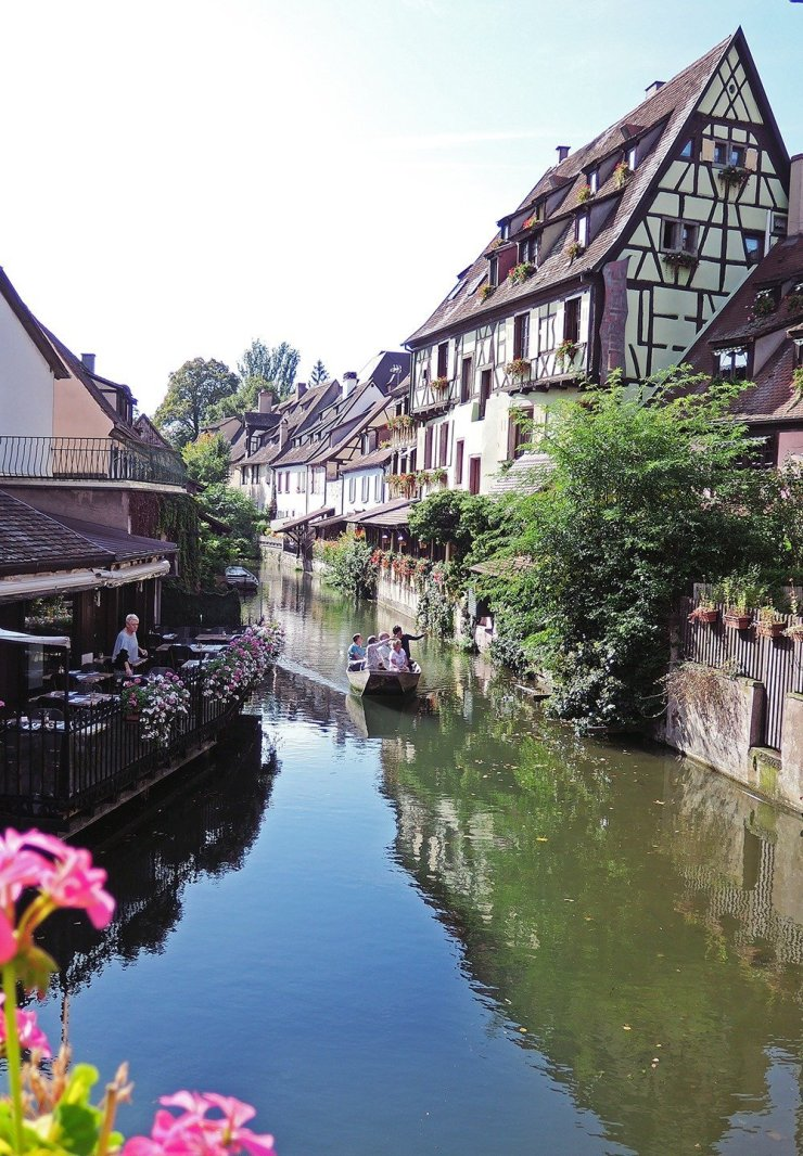 Live your best picture-perfect life with a boat trip around Colmar, the capital of Alsatian wine. This well-preserved medieval town shows the perfect marriage of the French and German cultures – from the architecture to the food to the language. Click through for more fun things to do in Alsace, France!