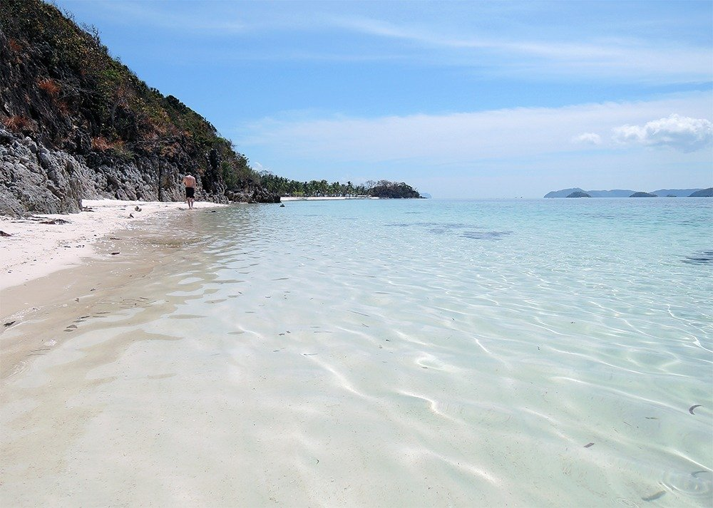 Spend the day beach bumming in Malcapuya island's long stretch of powdery white sand beach. Check out all the best things to do in Coron, Philippines.