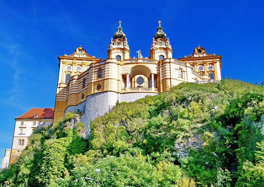 One of the stunning stopovers in this road trip itinerary from Vienna to Salzburg is Melk Abbey, one of the biggest European baroque complexes. Stop and enjoy the abbey's museum and gardens, and the view of the Danube river.