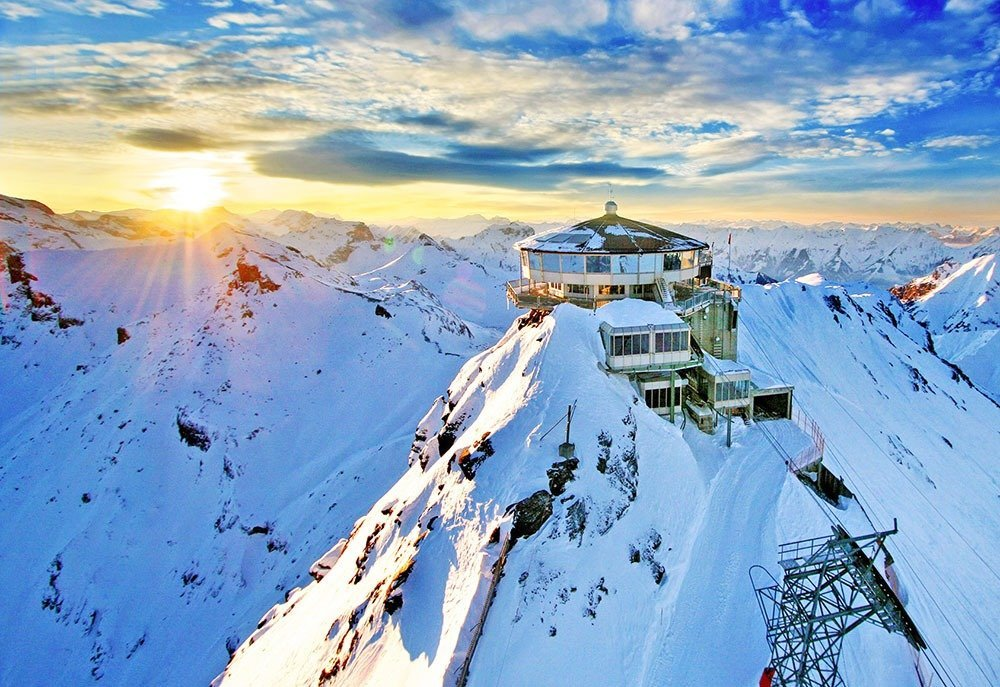Make your way up a series of cable car rides to the Schilthorn summit and enjoy the stunning views of the Swiss Alps.
