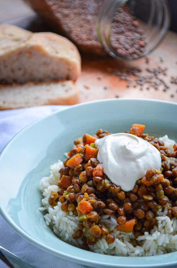 These flavorful Curry and Masala Lentils are a great meatless option for lunch or even supper! Served over hot cooked rice they make a complete meal, loaded with veggies and spiced perfectly. This is the BEST way to eat lentils!