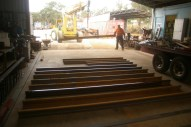 Laying all the rail out on the workshop floor with the crane