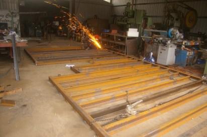 welding up the frame on the workshop floor