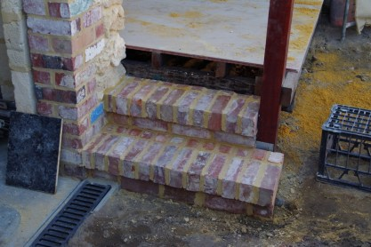 Brick steps up to the verandah