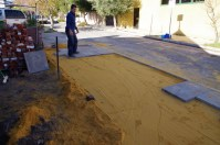 Relaying the concrete tiles that we pulled up nearly three years ago