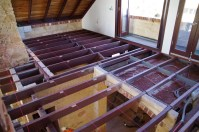Getting the joists level is an important part of the preparation for laying floorboards