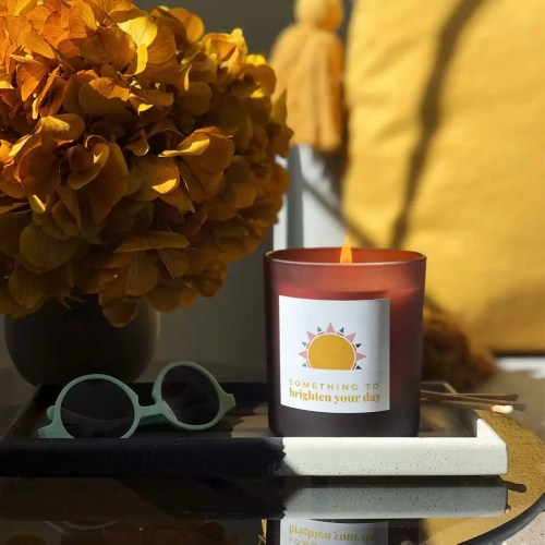 large refillable candle with sun design label