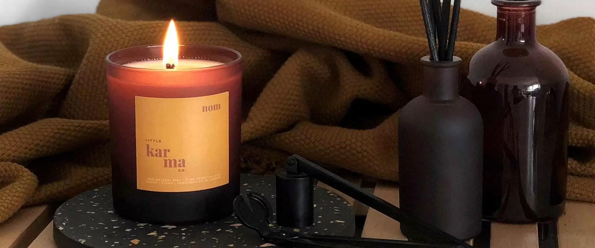 nom uplifting lemongrass ginger large candle in matt finish glass