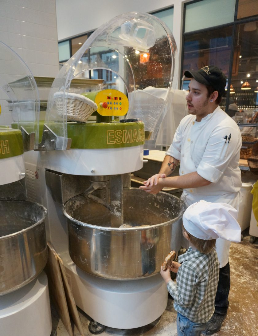 Helping mix the ingredients at Eataly Downtown