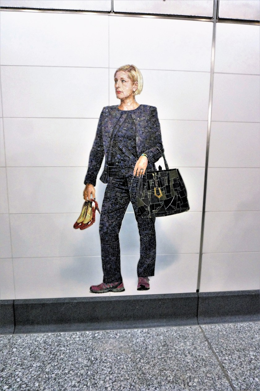 Woman holding shoes mural in Second Ave Subway