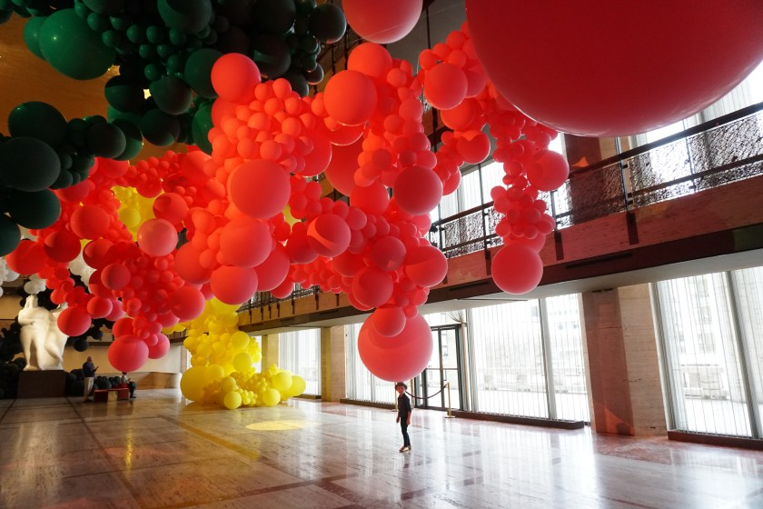 Standing under a balloon at the Geronimo Installation