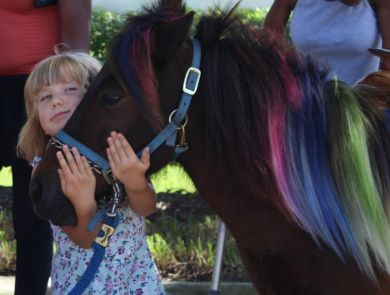 Amelia's little sister Adrianna giving Bongo some love.
