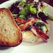 Classic brunch: egg over easy, bacon, toast and simple salad