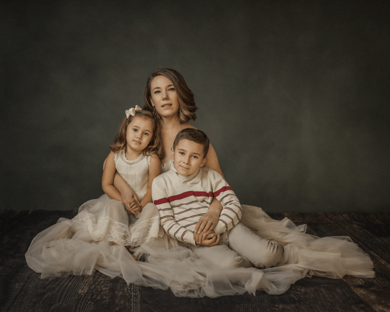 a mother and her two young children during a family photo session