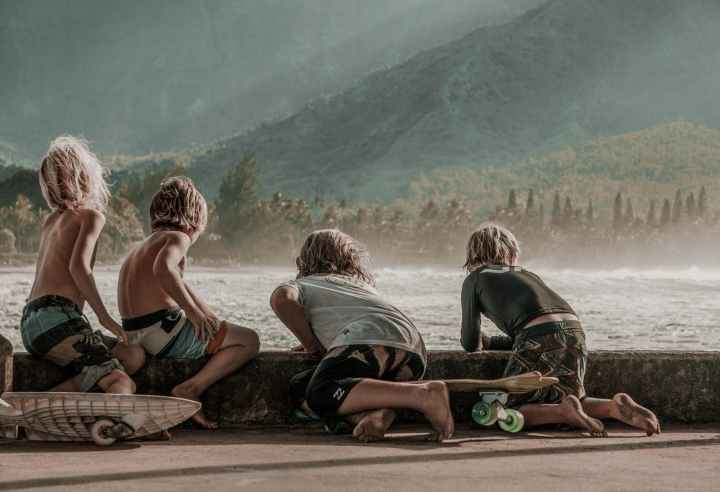 four children looking at sea
