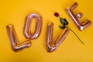 love letter balloons and red rose