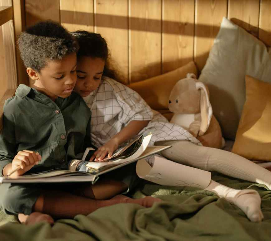 two kids reading a fairy tale book