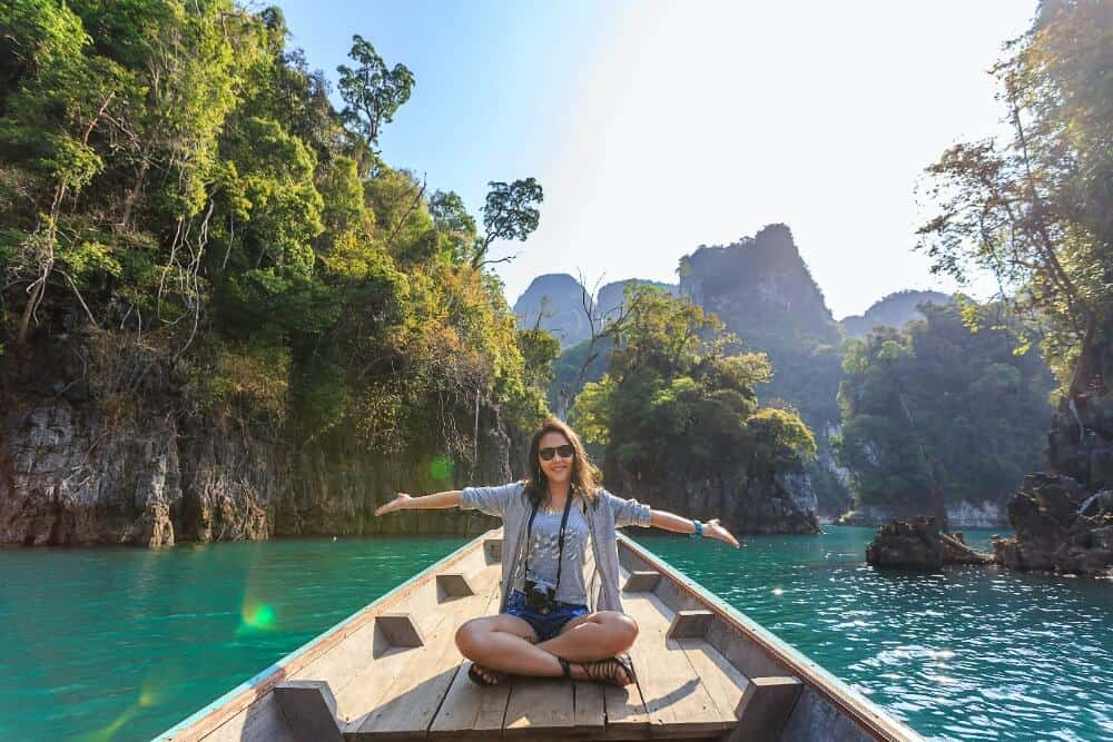 Woman in a boat for travelling alone while in a relationship.