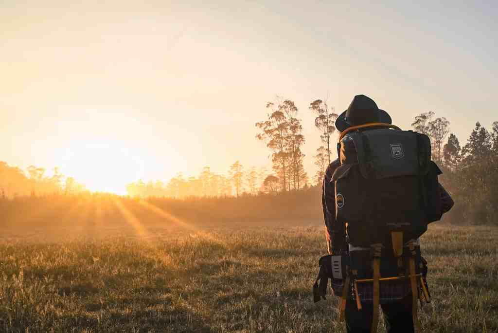 climate change and travel backpacker and sunset
