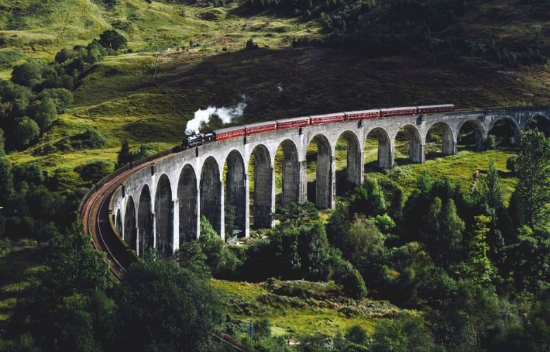 The curve of Glenfinnan Viaduct with the Jacobite Steam Train going over it.