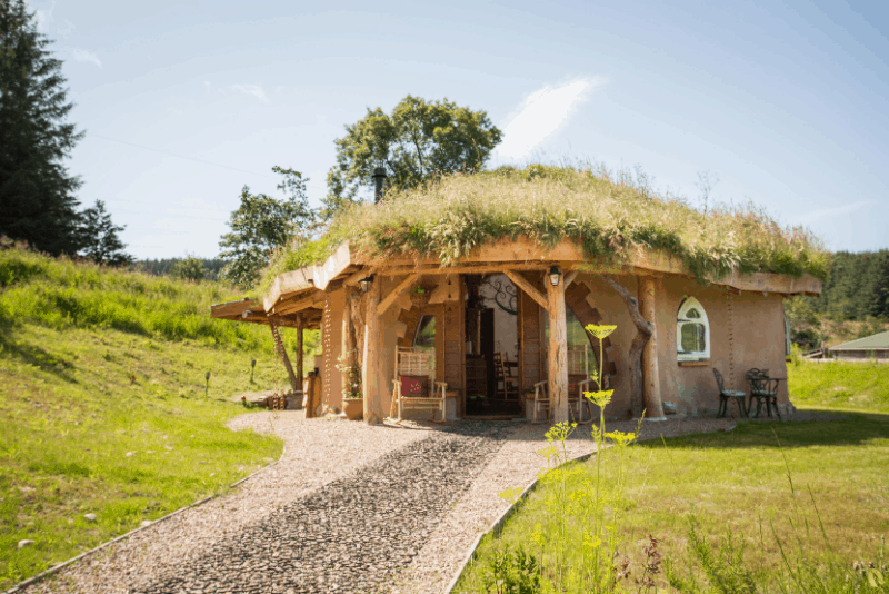 Exterior of the hobbit hideaay with a grassy roof - a unique getaway in Scotland