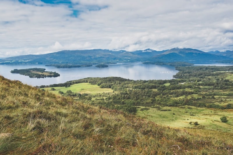 Loch Lomond is a must for your Scottish Highlands itinerary. The loch is surrounded by the hills of the Trossachs National Park.