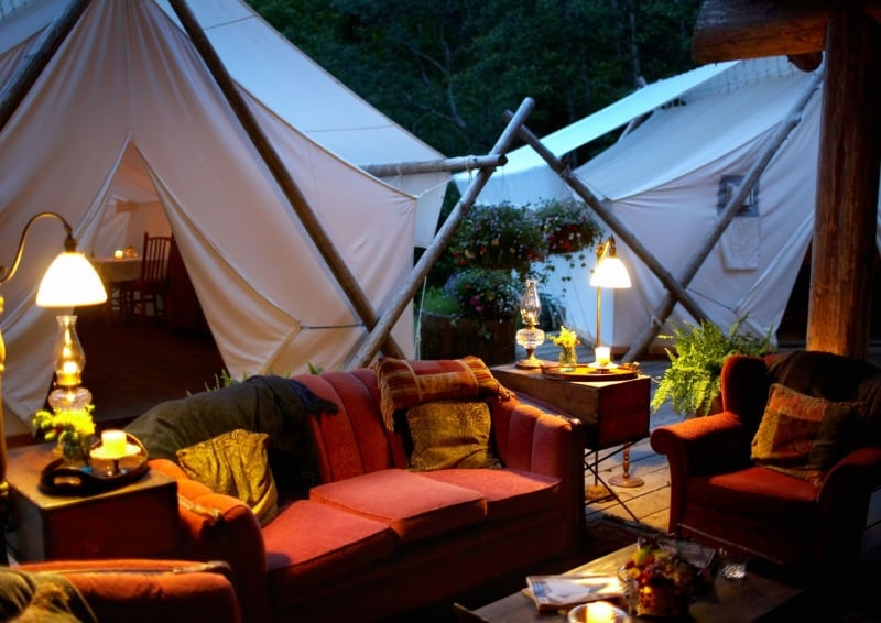 sofas and tents set up for DIY garden glamping.