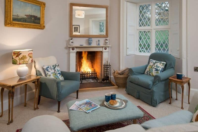 The hounge with a roaring fire in East Gatehouse Lodge