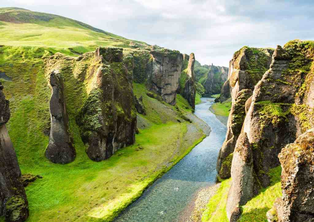 River through a canyon in Iceland, one of the most sustainable travel destinations in the world