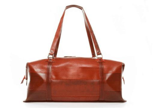 Elvis & Kresse fire-hose weekender bag in red.