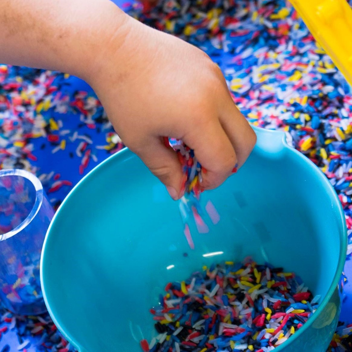 Sensory play with coloured rice