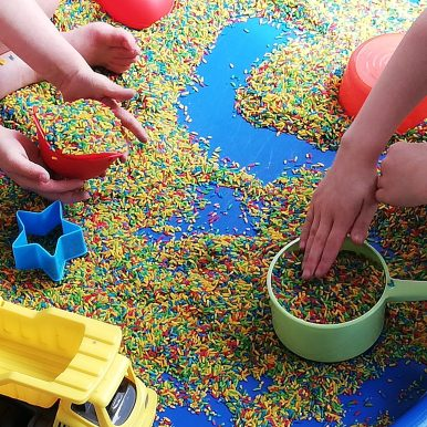 Sensory play with colourful rainbow rice
