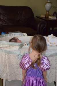 Sweet big sister watching