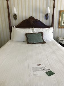 Bed located inside room at the Boardwalk Resort