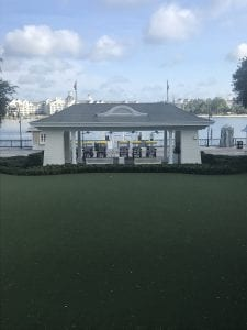 View of the Back of Disney's Boardwalk Hotel. Grass and water
