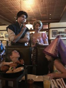 Rapunzel and Flynn Rider stopping for a quick conversation
