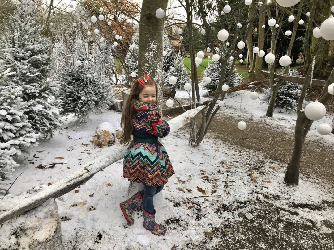 Eden hugging a tree to help the snow queen An Elf's Wish at Nevendon Manor