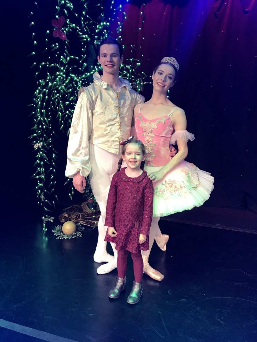 Eden with the princess and the frog on stage at her first ballet