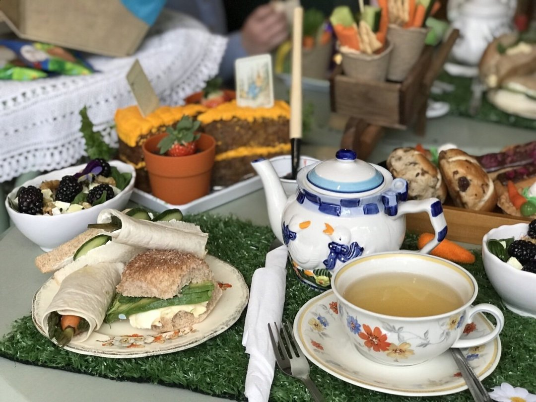 Tea cup and sandwiches A Tale of Peter rabbit themed afternoon tea