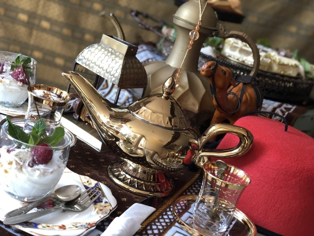 Gold magic lamp and crockery from genie's Dream Aladdin themed afternoon tea