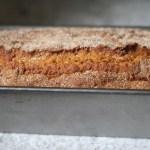 metal bread pan filled with freshly baked pumpkin bread