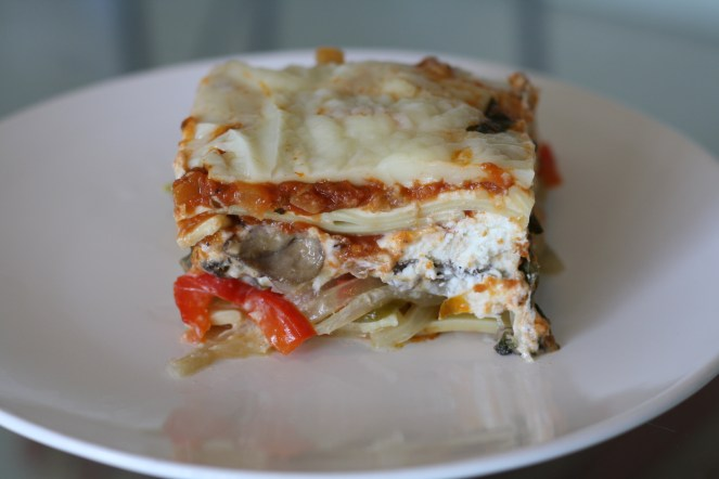 Slice of baked vegetable lasagna on a white plate