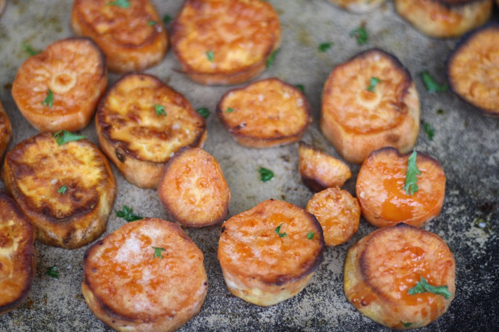 Caramelized sweet potatoes on baking sheet and ready to eat