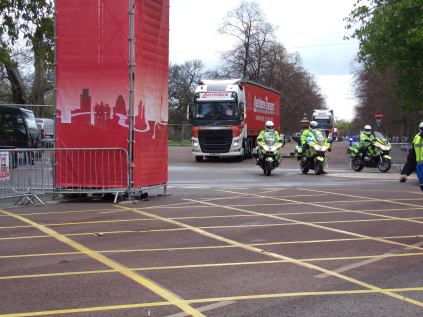 The runners' bags get a police escort to the finish