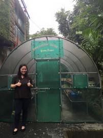 For lack of a photo showing only the greenhouse, there I am giving the thumbs-up.