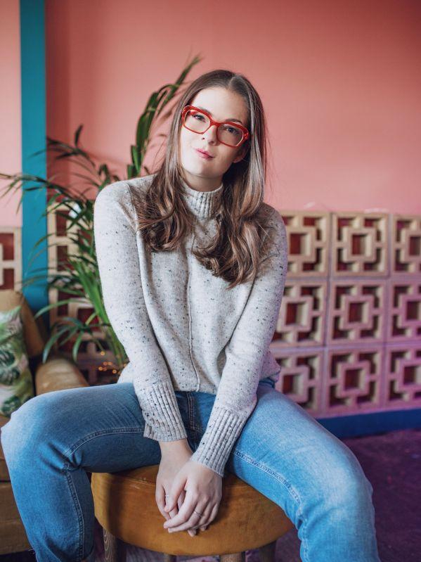 Kate Winney Lockdown Breakup Orange Glasses Grey Jumper