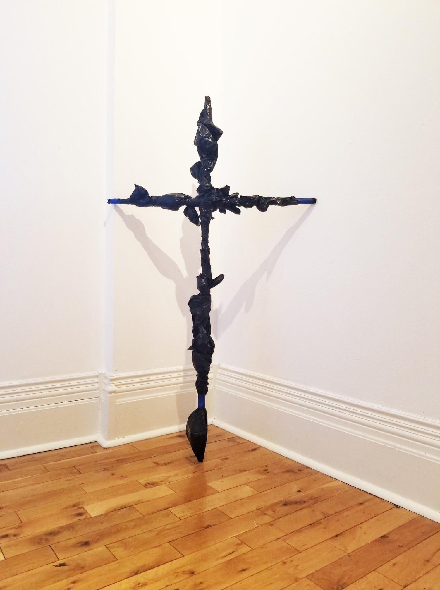 Garbage bag wrapped crucifix