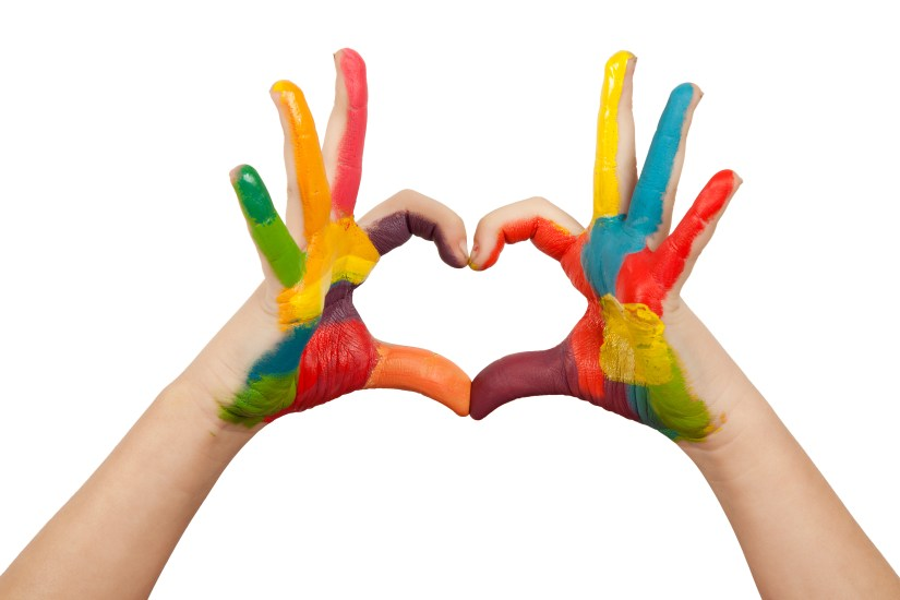 Hands forming a heart shape painted in multiple colors