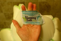 The bath's tag has information and is very well stitched onto the bath.