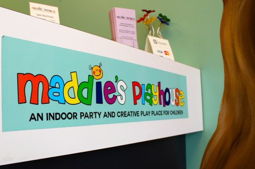 Welcome to a mini-photo series of Maddie's Playhouse. Behind this sign, you will see a happy staff-member waiting to greet you.